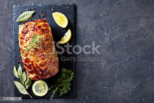 with lemon slices and fresh thyme on a concrete table, view from above, flat lay, copy space