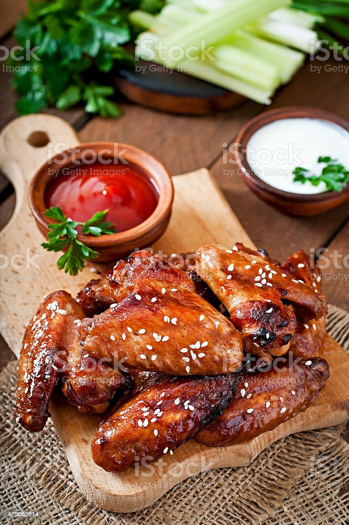 Baked chicken wings with teriyaki sauce stock photo