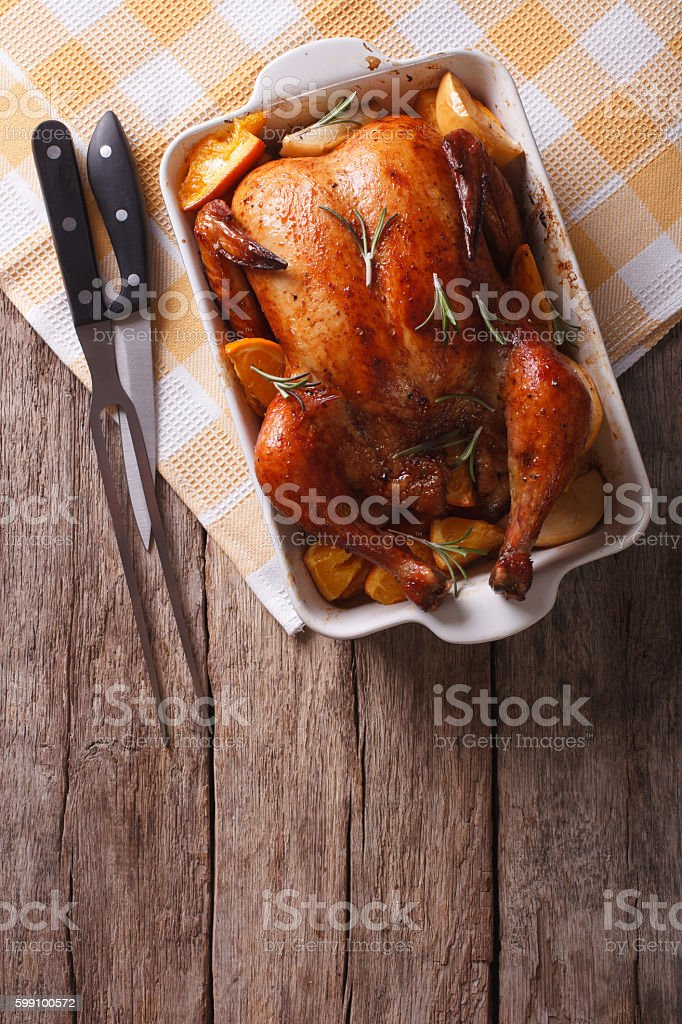 baked chicken with apples in baking dish. vertical top view stock photo