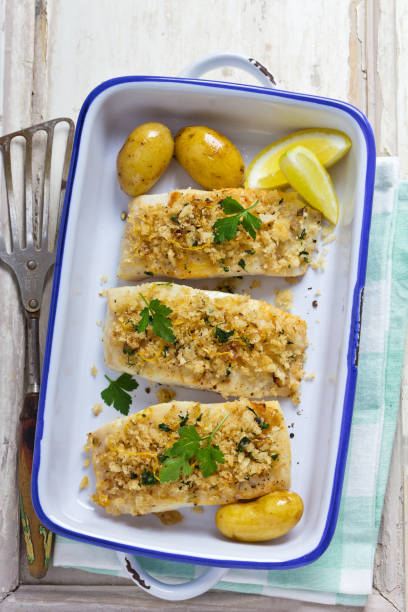 Baked cod fillets with potatoes stock photo