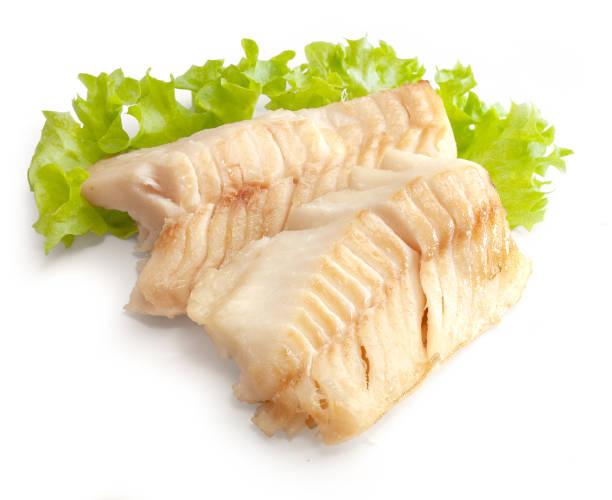 baked cod loin with lettuce - cod imagens e fotografias de stock