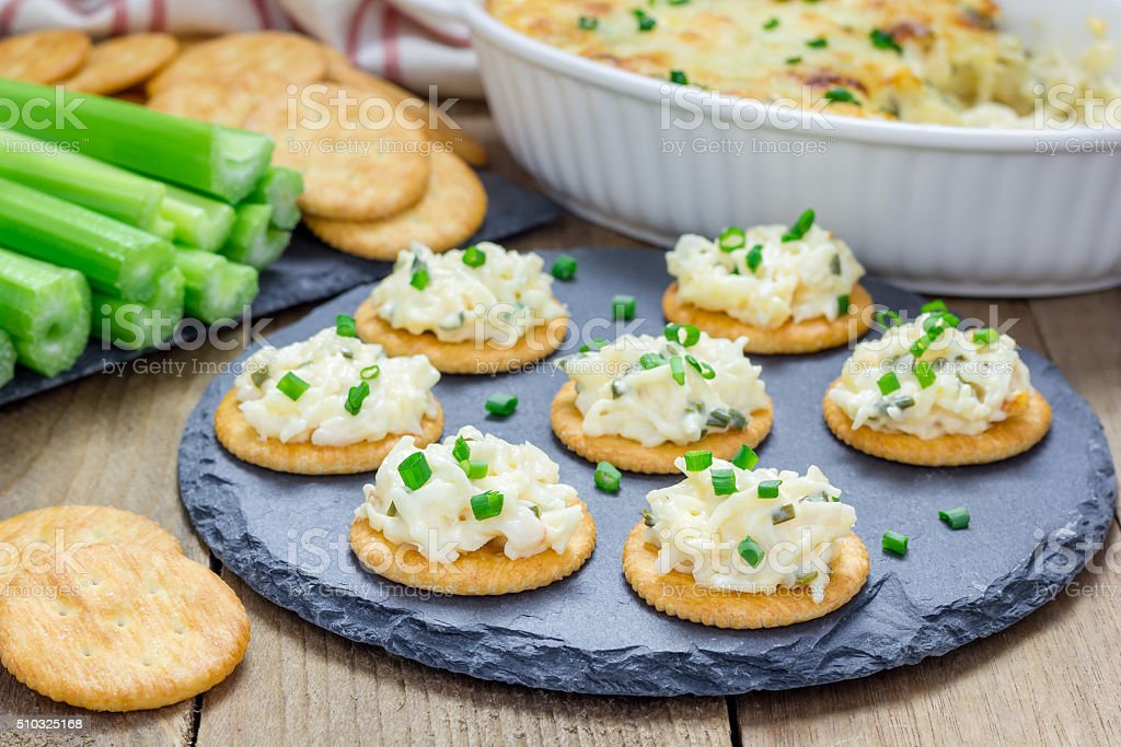 Baked crab dip, served with celery sticks and crackers stock photo