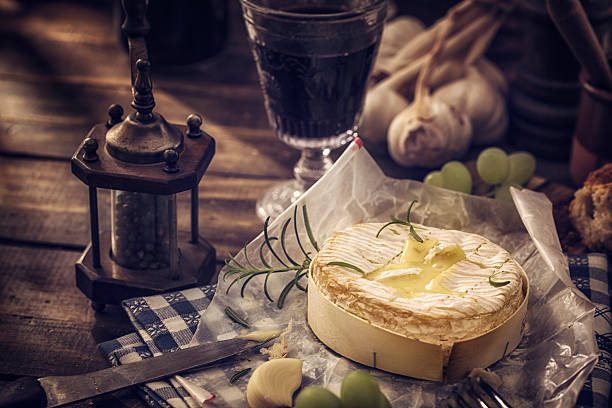 baked creamy and soft camembert cheese - baked brie stock photos and pictures