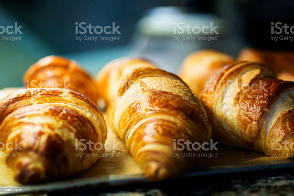 Baked croissants on a metal tray stock photo