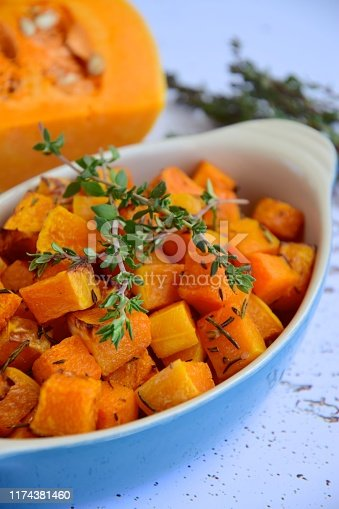 Baked diced pumpkin with thyme. Selective focus