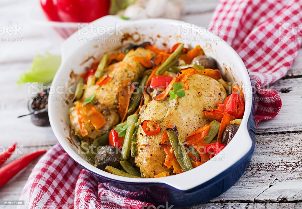 Baked, diet and healthy a chicken fillet with vegetables. stock photo