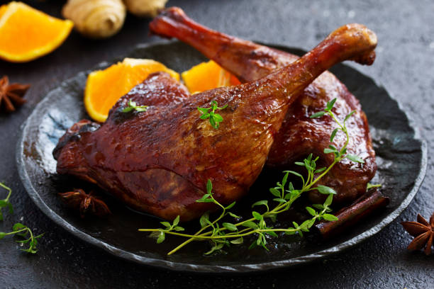 Baked duck leg in Chinese. stock photo