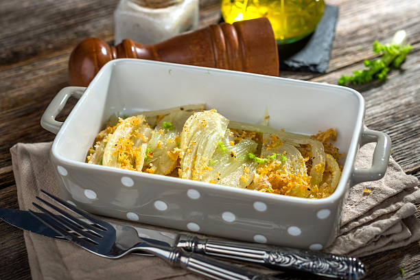 Baked Fennel with Parmesan Baked Fennel with Parmesan fennel stock pictures, royalty-free photos & images