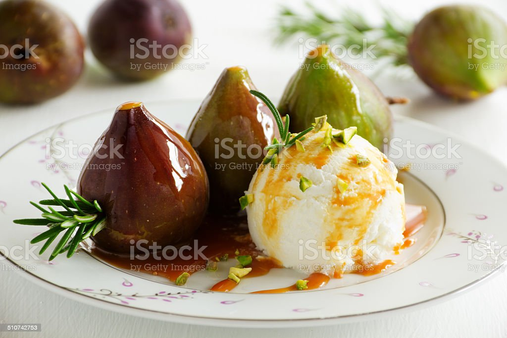 Baked figs with caramel and ice cream. Baked figs with caramel and ice cream. Appetizer Stock Photo