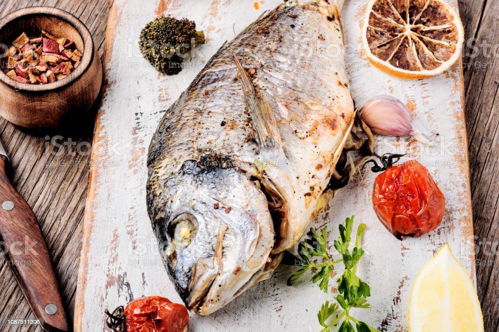 Baked fish dorado stock photo