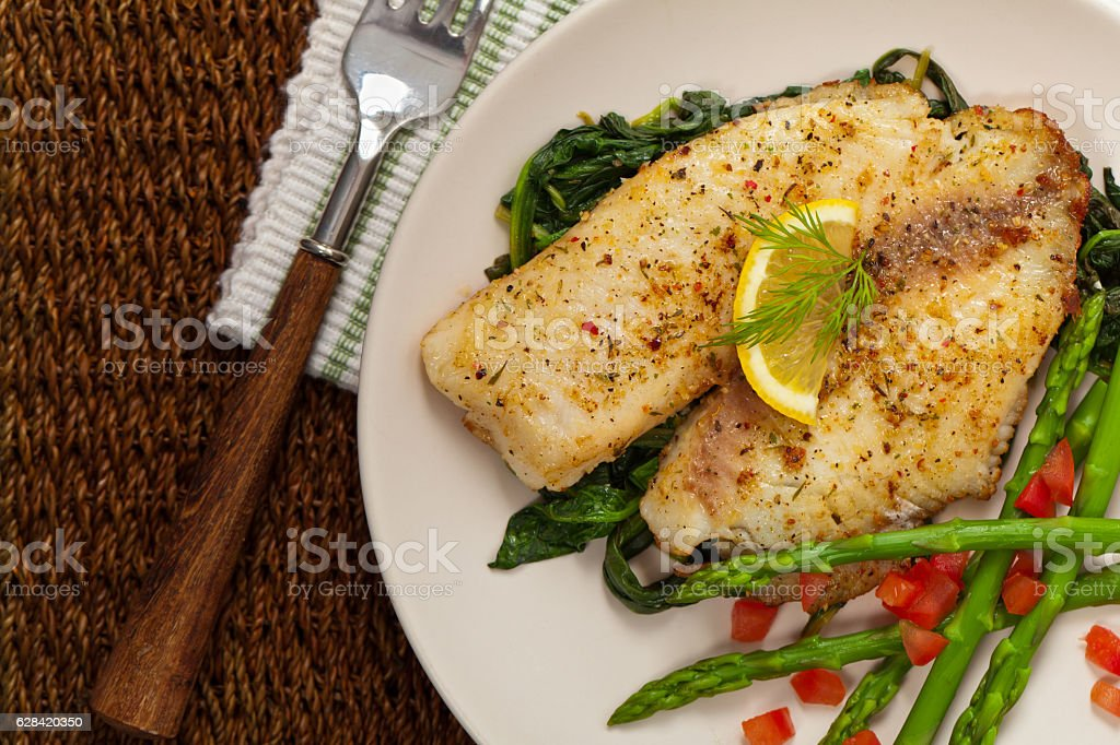 Baked Fish Fillet Whitefish with Roasted Asparagus. Selective focus. Asparagus Stock Photo