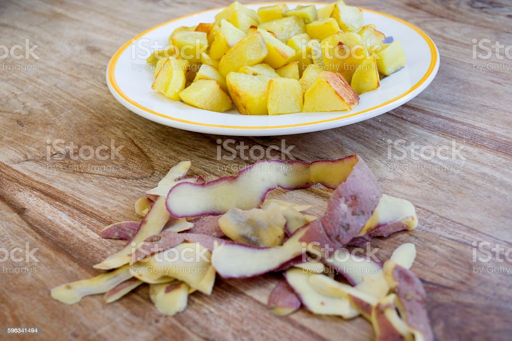 baked flavored potatoes with near Its peels royalty-free stock photo