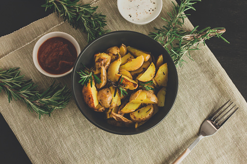 istock Baked fried potatoes with rosemary. 1132605531