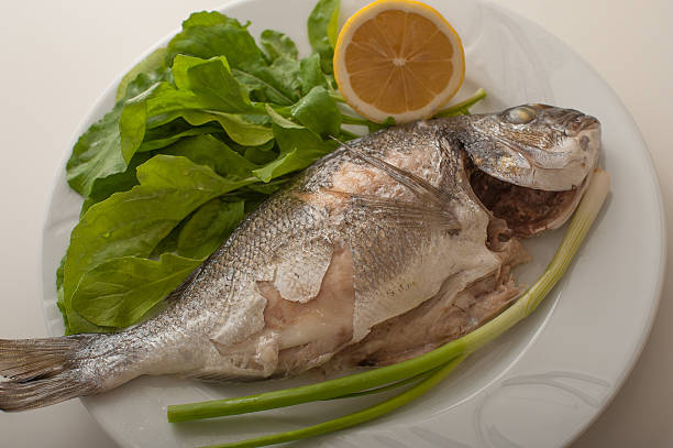 Baked gilthead on plate stock photo
