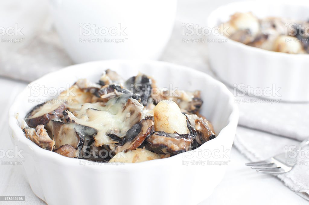 Baked gratin of cheese, mushrooms and potato stock photo