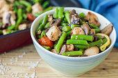 Baked green beans, chicken meat, cherry tomatoes, mushrooms, lemon, sesame