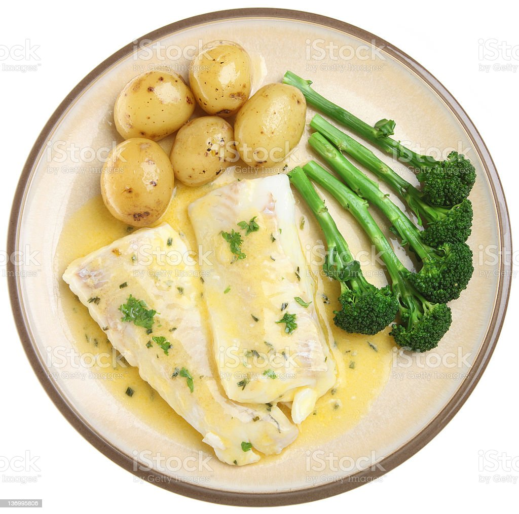 Baked Haddock Fish Fillets & Vegetables royalty-free stock photo