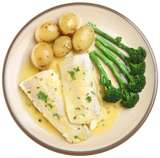 Baked Haddock Fish Fillets & Vegetables stock photo