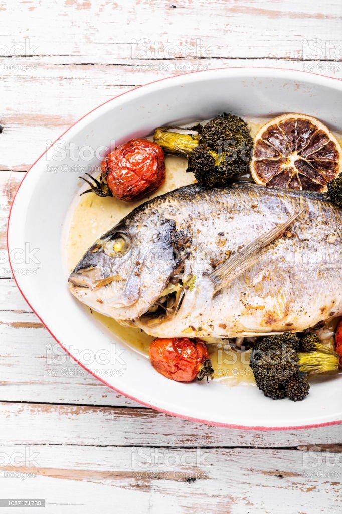 Baked in oven sea fish dorado stock photo