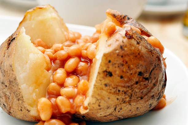baked jacket potato filled with  beans stock photo