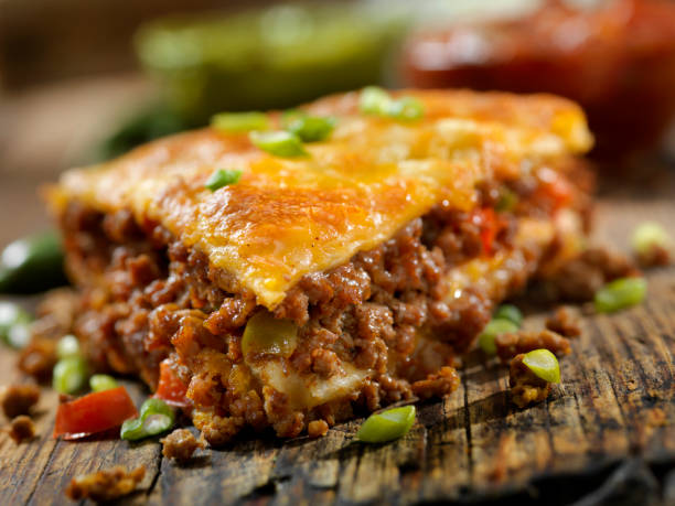 Baked, Layered, Beef Taco Pie with Sour Cream, Salsa and Guacamole stock photo