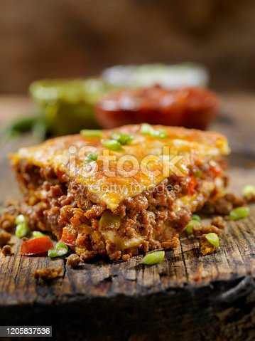 Baked, Layered, Beef Taco Pie with Sour Cream, Salsa and Guacamole