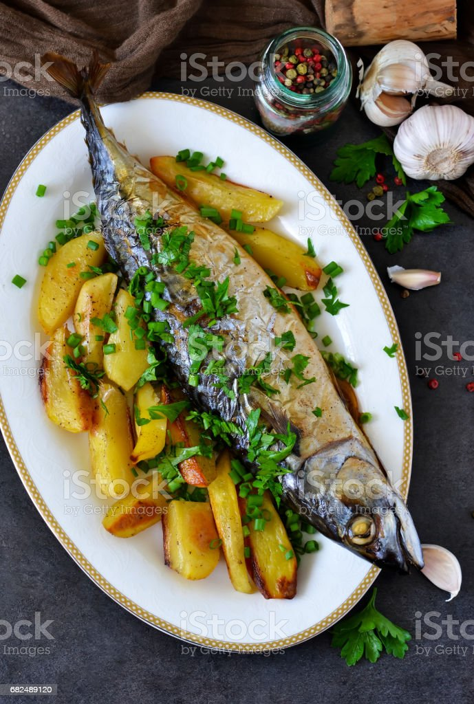 Baked mackerel with potatoes and spices for dinner royalty-free stock photo