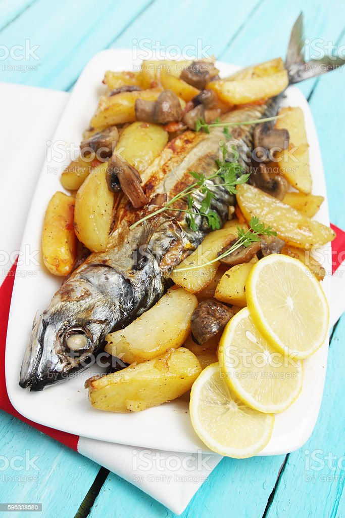 Baked mackerel with vegetables royalty-free stock photo