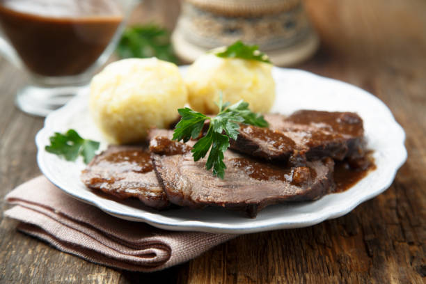 Baked meat with spicy sauce Baked meat or Sauerbraten with spicy sauce and potato dumplings czech culture stock pictures, royalty-free photos & images