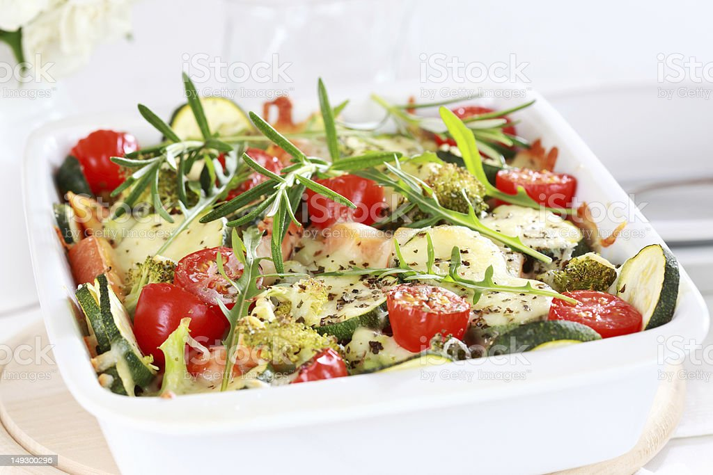 Baked mixed vegetables with seasoning in a white dish stock photo