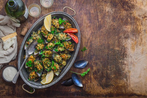 Baked mussels with cheese parmesan and bread crumbs, copy space stock photo
