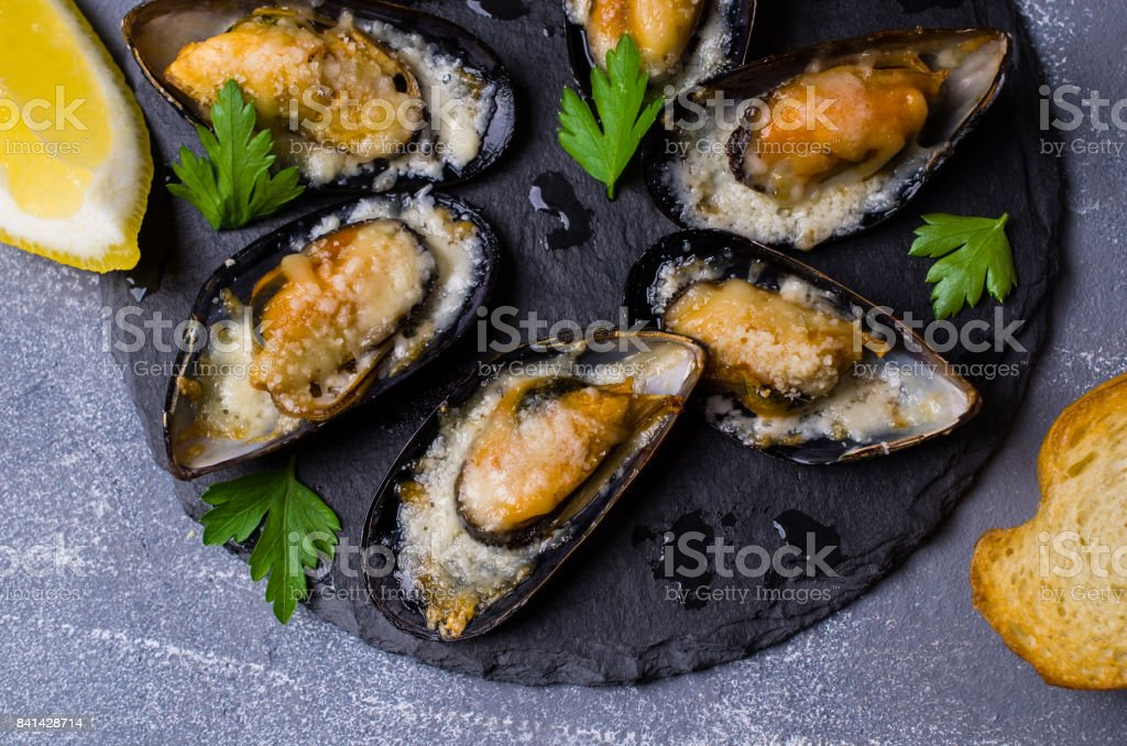 Baked mussels with cheese stock photo