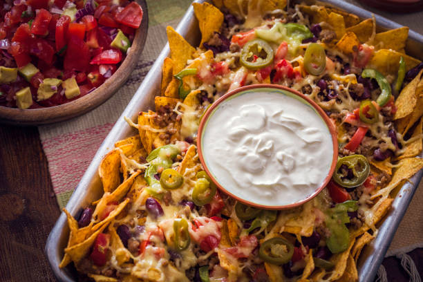 Baked Nachos Tortilla Chips with Salsa, Minced Meat and Jalapenos stock photo
