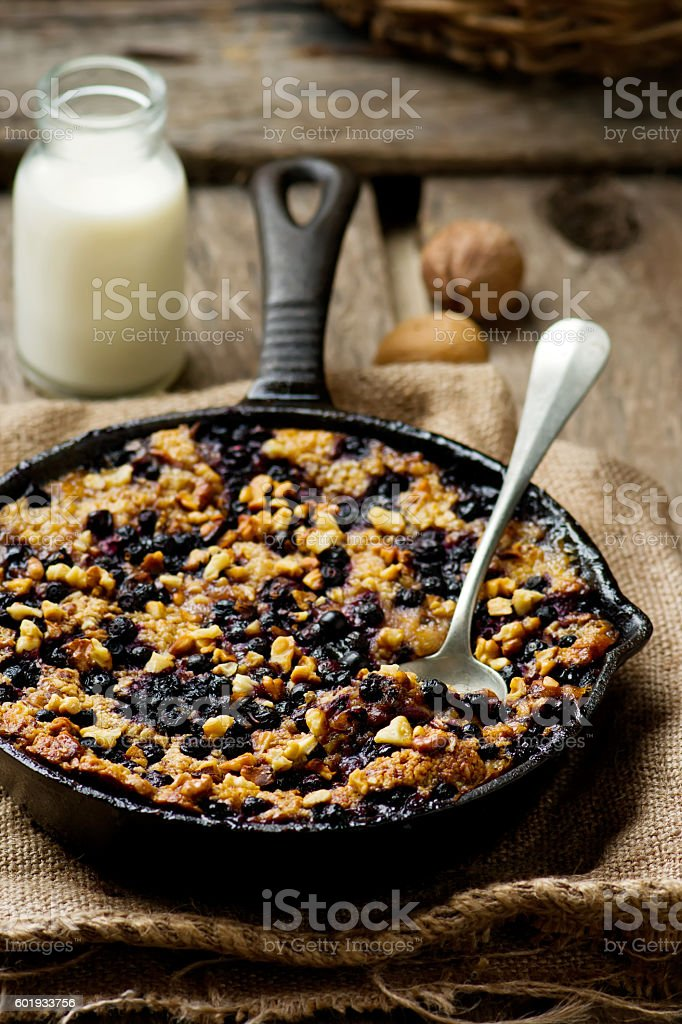 Baked Oatmeal in a pig-iron frying pan stock photo