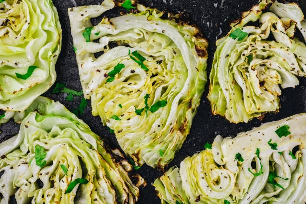 baked or grilled white cabbage pieces - cavolo foto e immagini stock