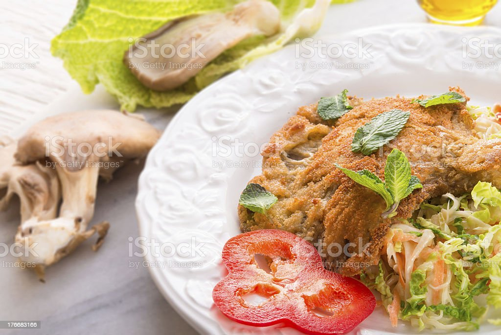baked oyster mushrooms with fresh savoy cabbage salad royalty-free stock photo