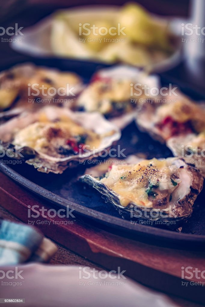 Baked Oysters Served on Plate stock photo