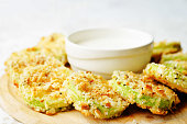 baked parmesan zucchini crisps with cream sauce. the toning. selective focus