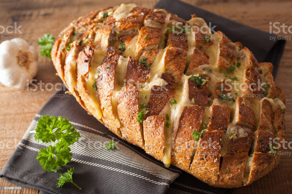 baked party bread with melted cheese butter herbs stock photo
