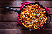 Healthy Pasta in Cast Iron Skillet with Tomato, Basil, Bell Pepper, Onion, Garlic and Parmesan Cheese