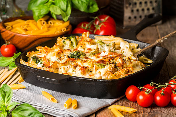baked pasta with broccoli, cauliflower, cheese and bechamel sauc - casserole stock photos and pictures