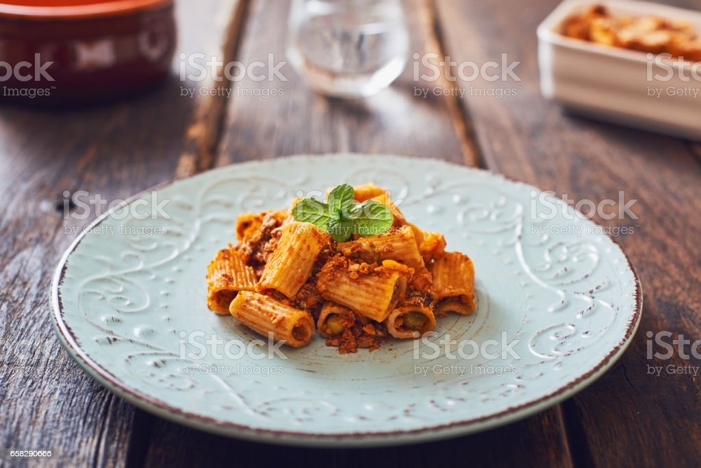 Baked pasta with mince, ragù sauce. stock photo