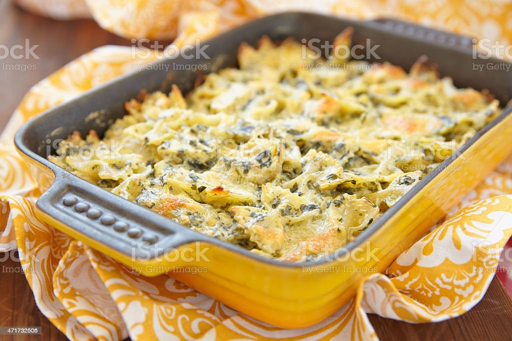 Baked pasta with spinach stock photo