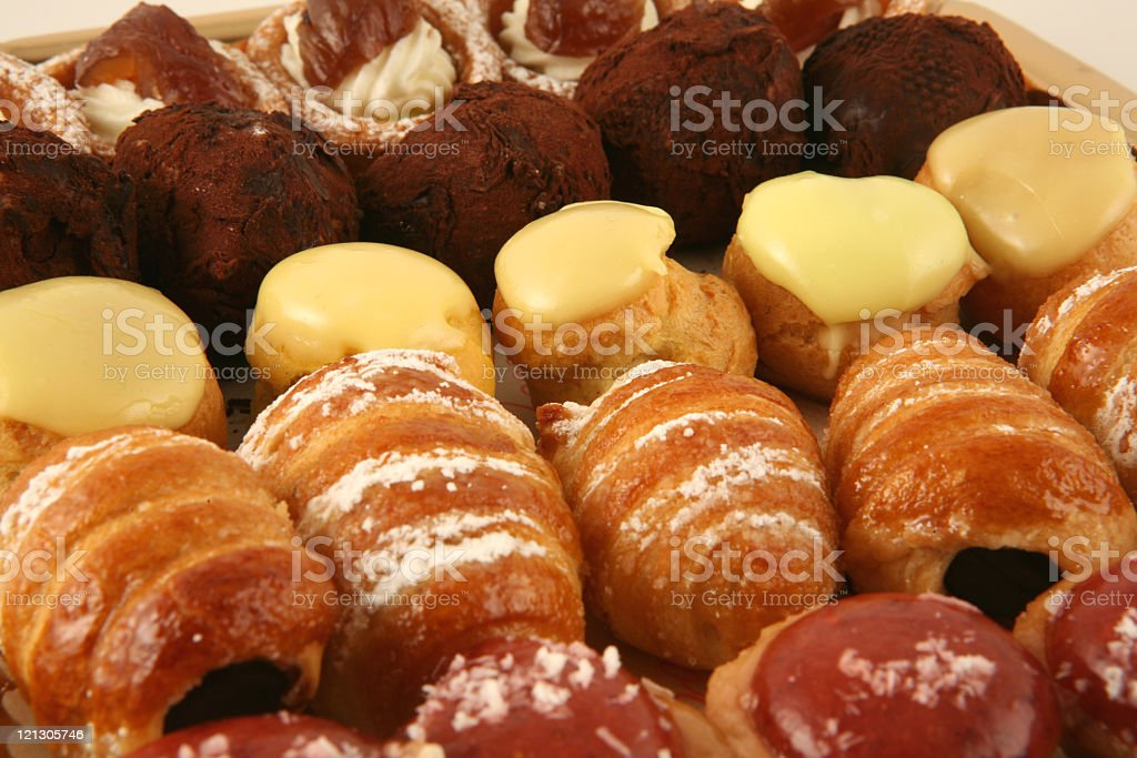 Baked pastries waiting to be packaged royalty-free stock photo
