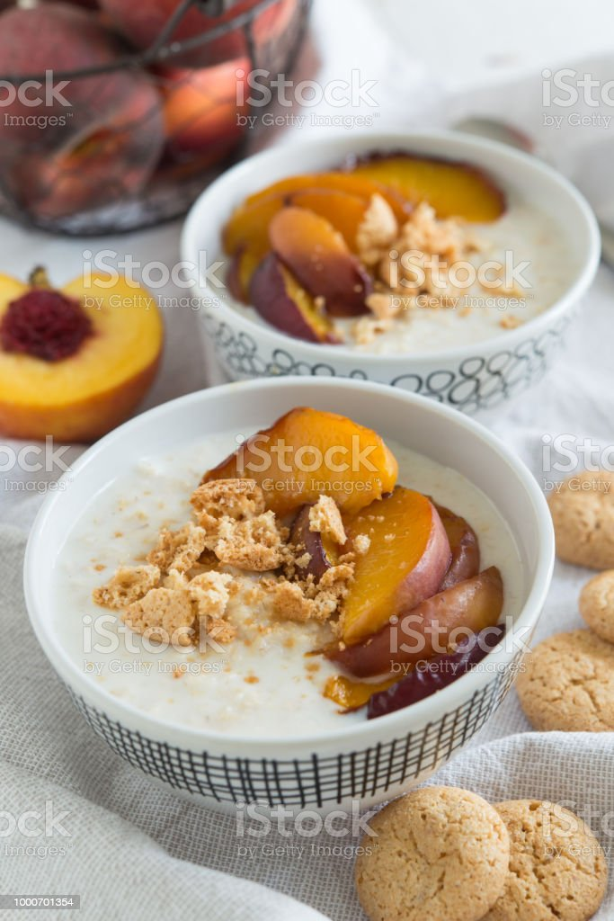 Baked peach and amaretti oatmeal stock photo