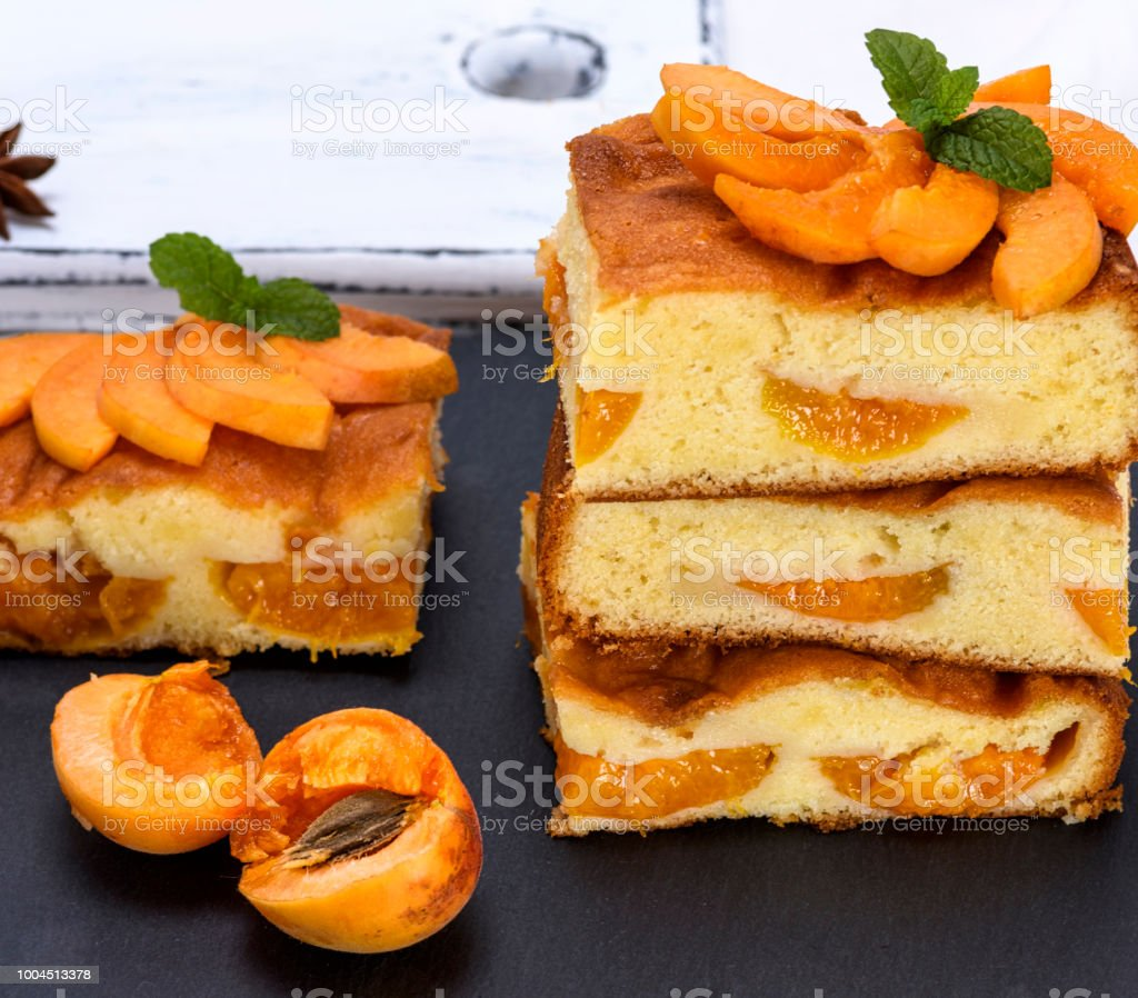 baked pieces of biscuit pie with apricots stock photo