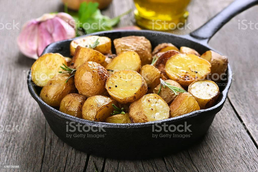 Baked potato in frying pan stock photo
