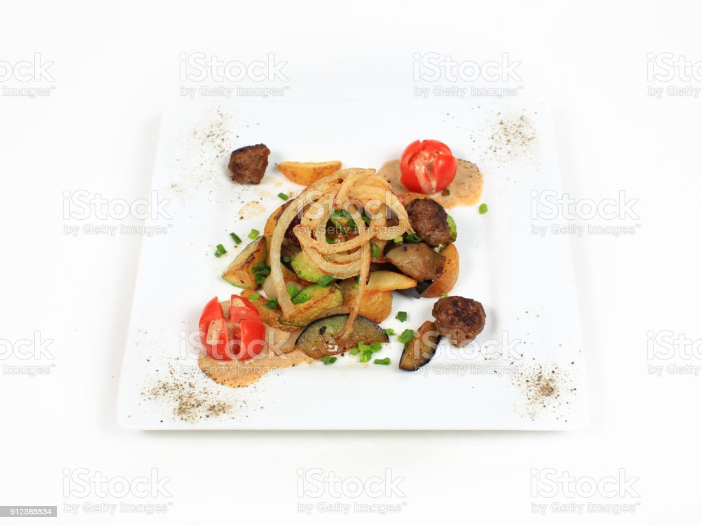 Baked Potato Topped with meat and tomato stock photo