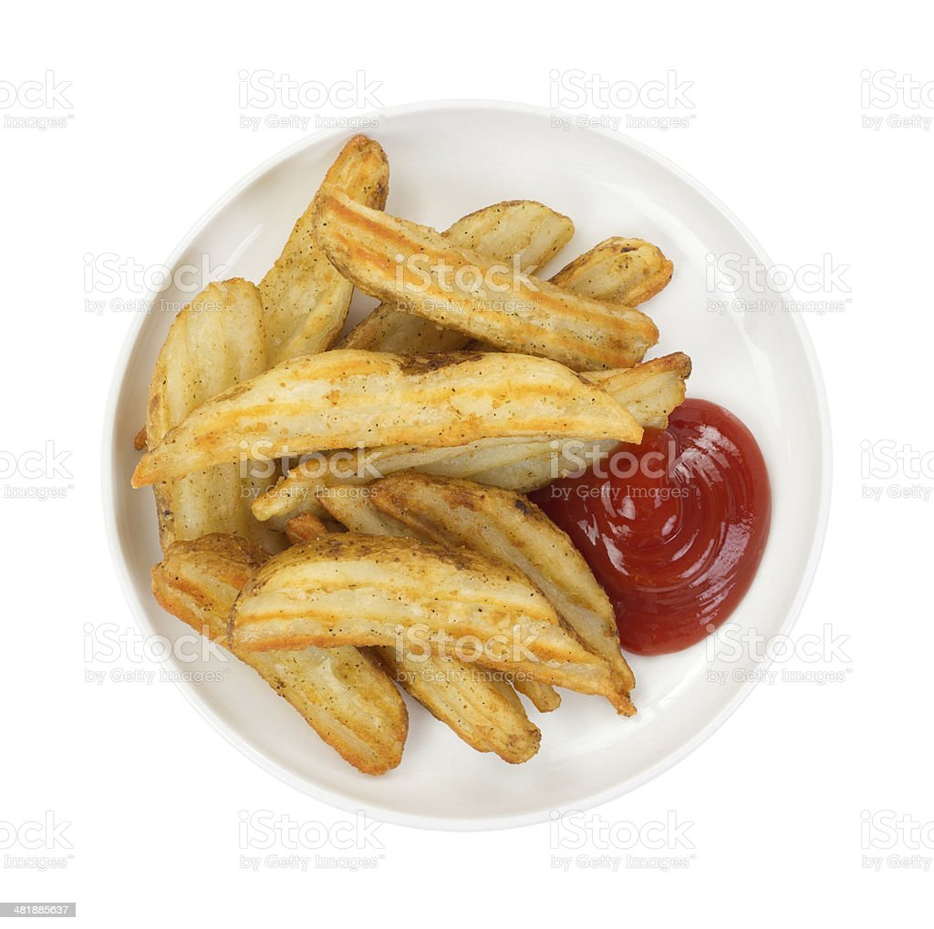 Baked potato wedges in dish with ketchup stock photo