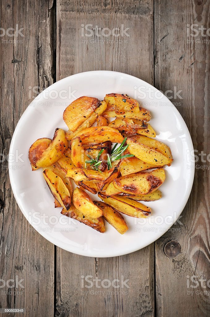 Baked potato wedges, top view stock photo